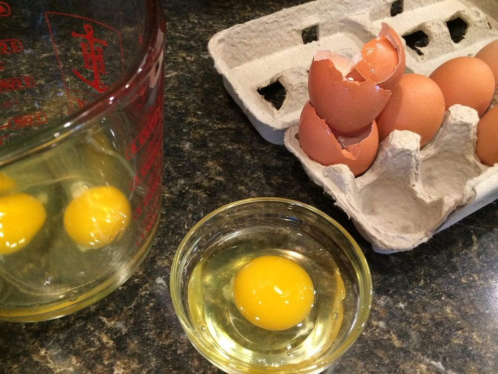 Cracking eggs in a bowl
