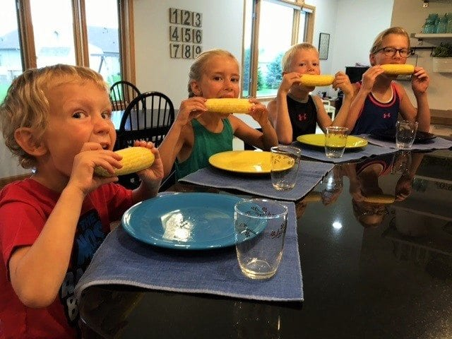 Kids with corn on the cob
