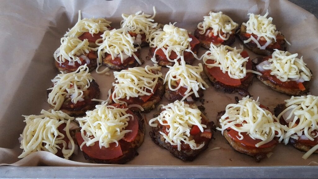 Adding the Ingredients to Mini Eggplant Pizzas
