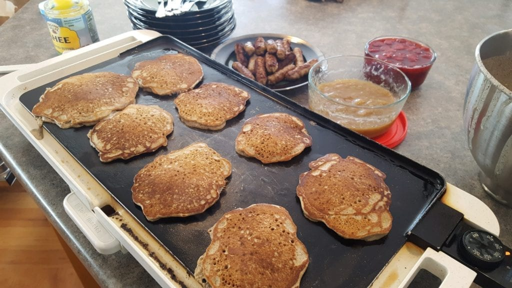 gluten free pancakes on the griddle