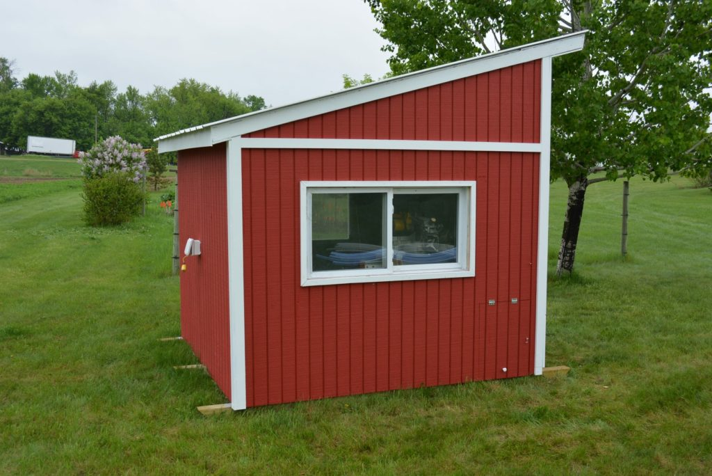 finished red chicken coop
